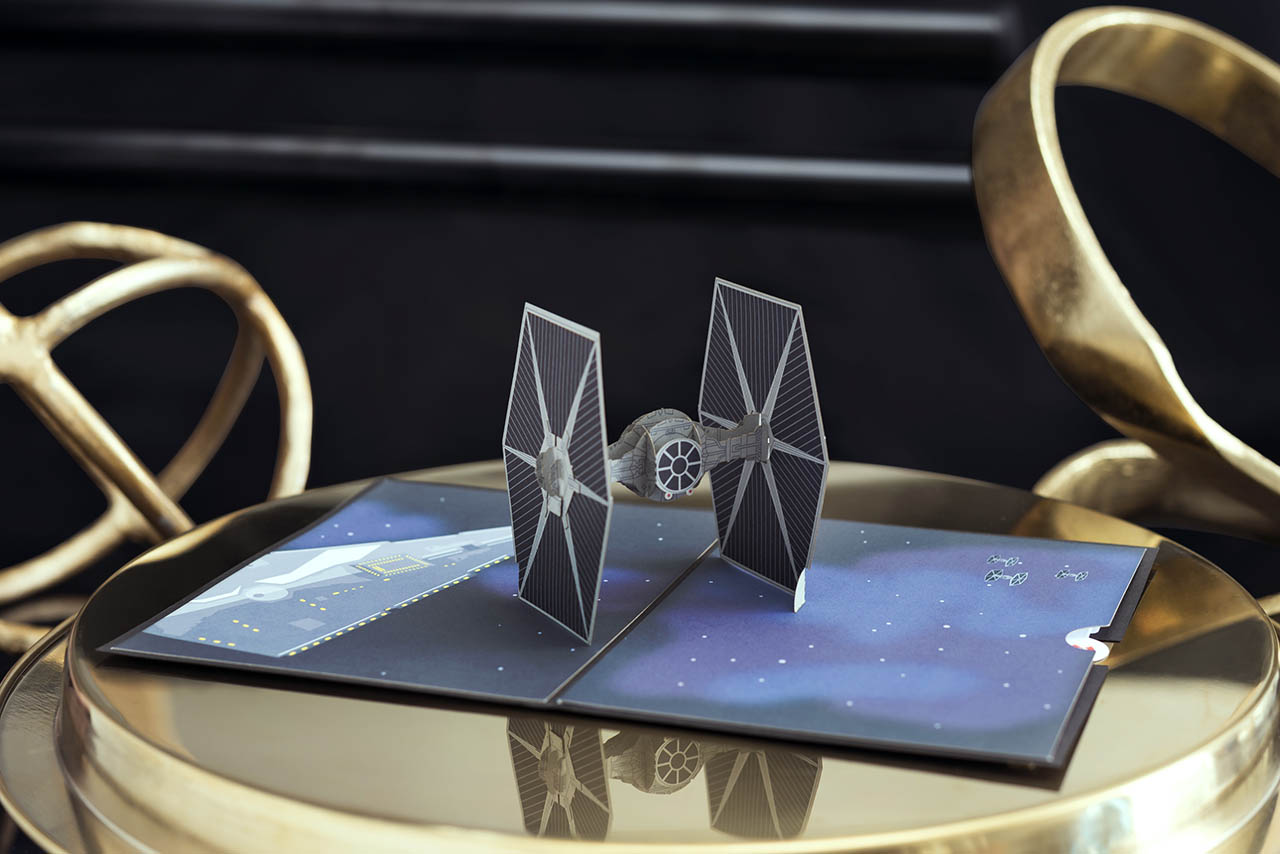 A Star Wars Lovepop card featuring a TIE fighter.