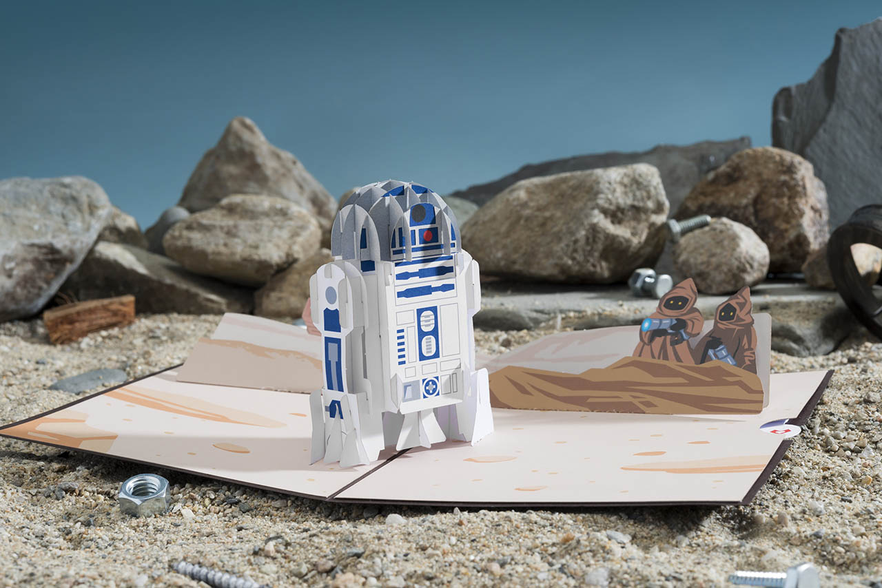 A Star Wars Lovepop card featuring R2-D2 in the desert.