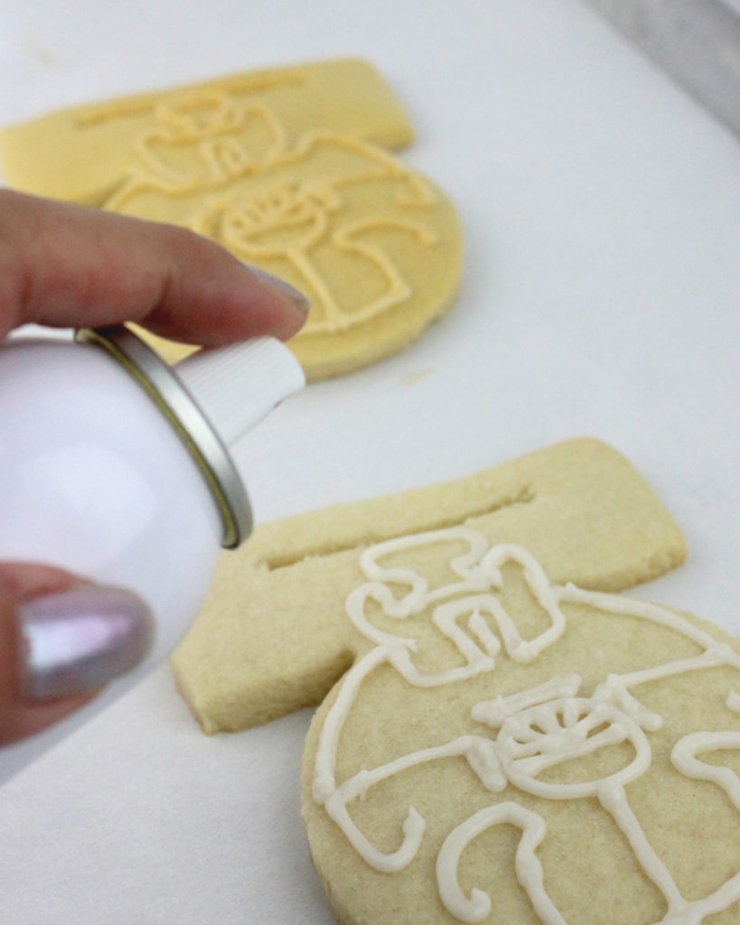 Layering details onto a Medal of Yavin cookie.