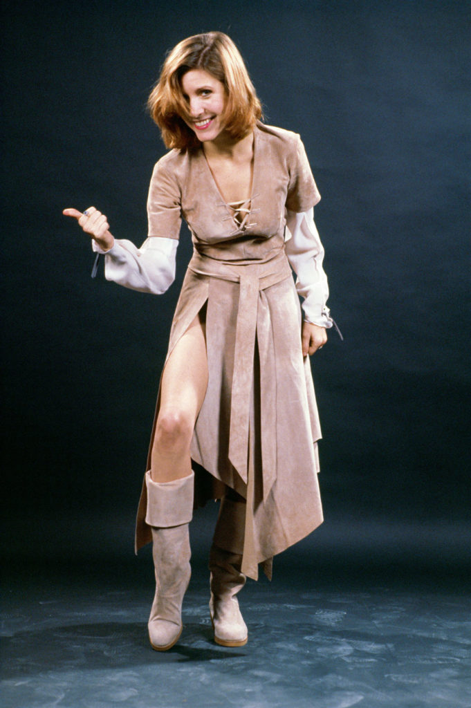 Star Wars Archives photo of Carrie Fisher clowning as she models her Endor costume.
