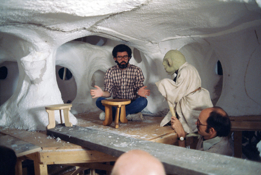 Star Wars Archives photo of George Lucas on the set of Yoda's hut for Star Wars: The Empire Strikes Back.