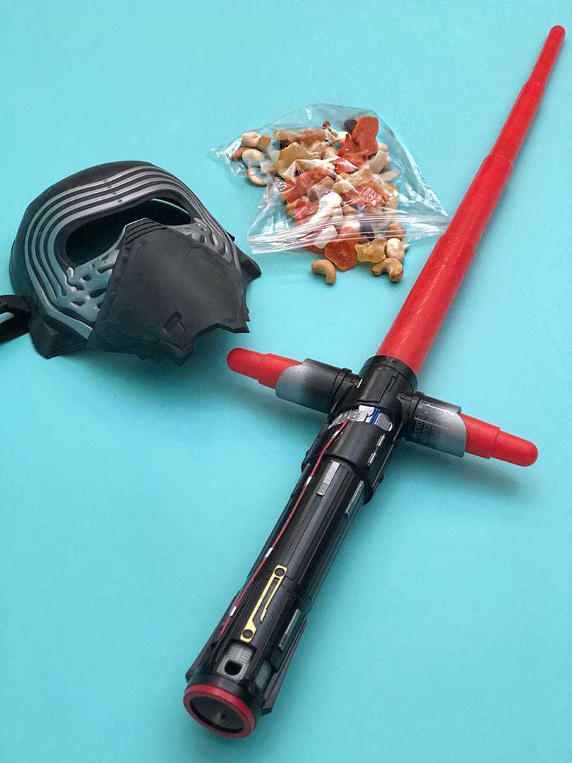 A snack bag and supplies to make a Star Wars Celebration cosplay.