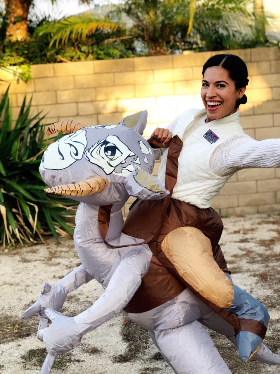 Jennifer Landa cosplays with a tauntaun.