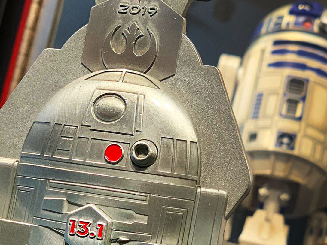 Silver R2-D2 medallion awarding the completion of a half marathon, or 13.1 miles