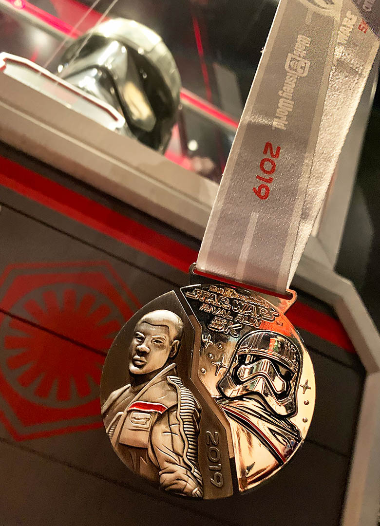 runDisney medal for Star Wars Rival Run 5K | Finn and Captain Phasma.