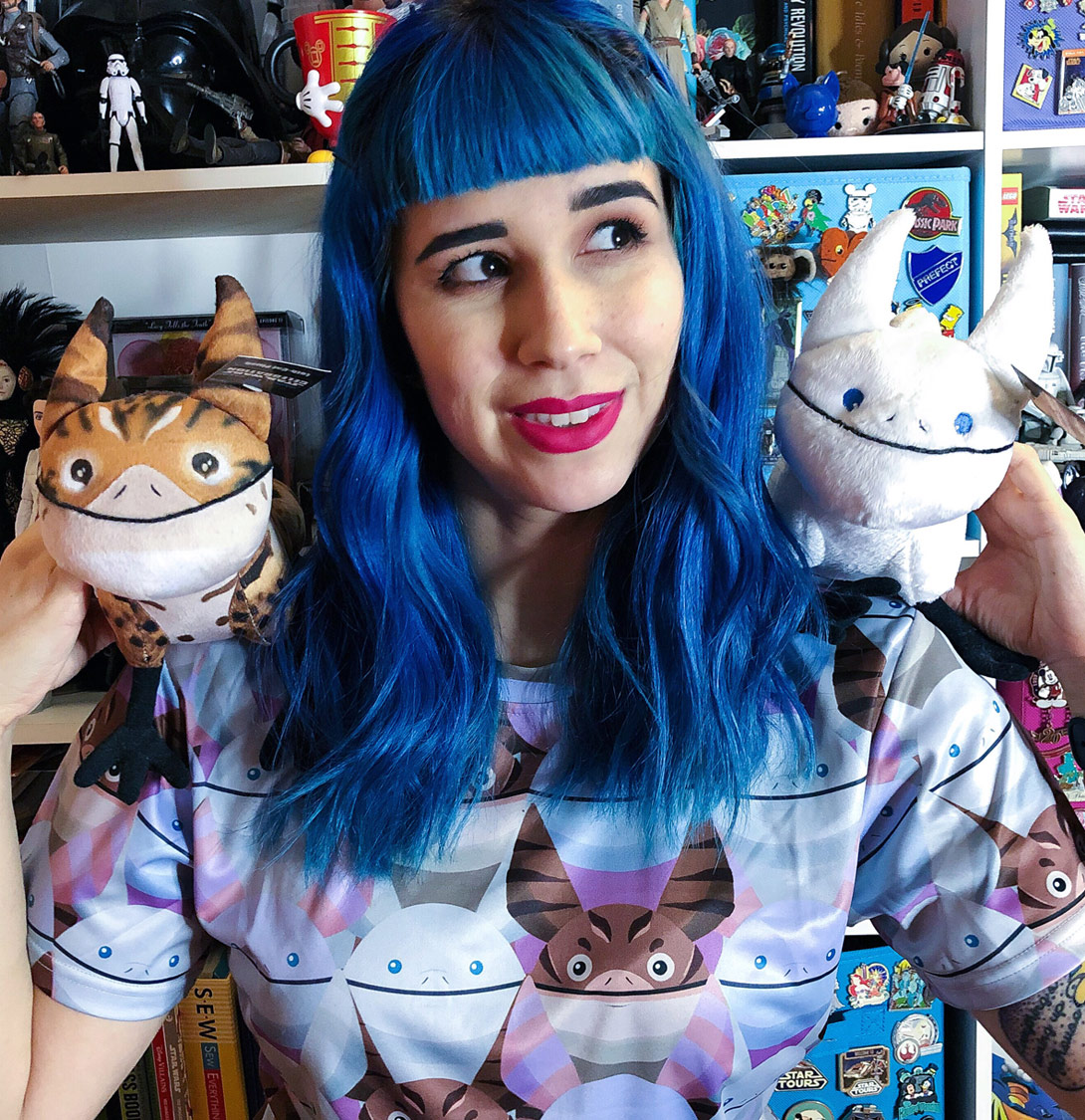 Amanda Jean Camarillo holding two Loth-cats