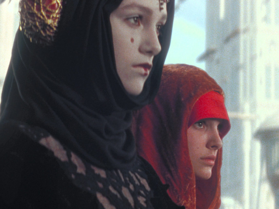 Padme Amidala standing beside her decoy on Coruscant