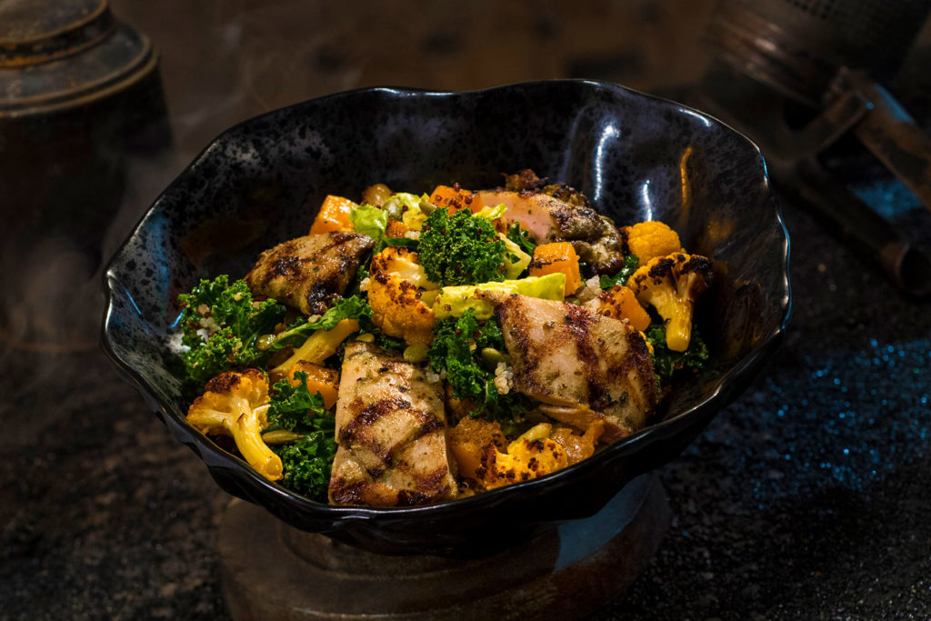 The Oven-roasted Tip Yip, found at Docking Bay 7 Food and Cargo inside Star Wars: Galaxy's Edge, features roasted chicken with mixed greens, roasted vegetables, quinoa and pumpkin seeds with a creamy green curry ranch dressing. (David Roark/Disney Parks)