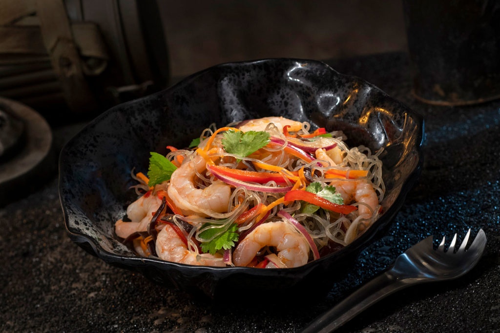 The Yobshrimp Noodle Salad, found at Docking Bay 7 Food and Cargo inside Star Wars: Galaxy's Edge, is a marinated noodle salad with chilled shrimp. (David Roark/Disney Parks)
