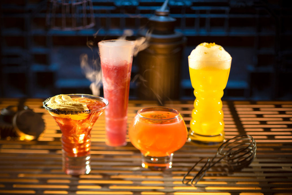From left to right, alcoholic beverages: The Outer Rim, Bespin Fizz, Yub Nub, and Fuzzy Tauntaun can be found at Oga's Cantina inside Star Wars: Galaxy's Edge. (Kent Phillips/Disney Parks)