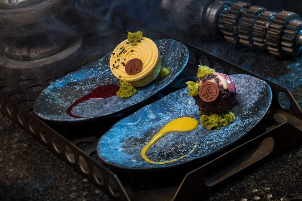 Guests can indulge in a raspberry crème puff with passion fruit mousse (left) or chocolate cake with white chocolate mouse and coffee custard (right) at Docking Bay 7 Food and Cargo inside Star Wars: Galaxy's Edge. (David Roark/Disney Parks)