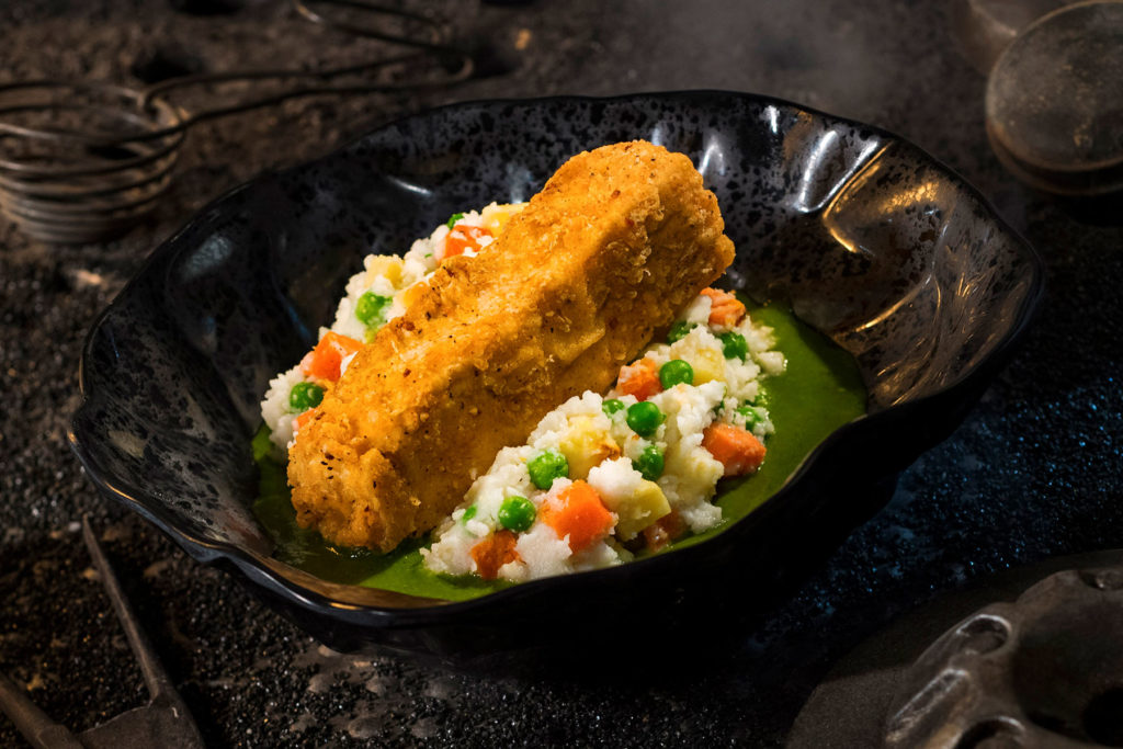 The Fried Endorian Tip-Yip, found at Docking Bay 7 Food and Cargo inside Star Wars: Galaxy's Edge, is a decadent chicken dish with roasted vegetable mash and herb gravy. (David Roark/Disney Parks)