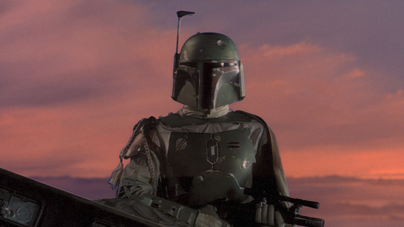 Boba Fett watches as Han is loaded into the Slave I in Star Wars: The Empire Strikes Back.