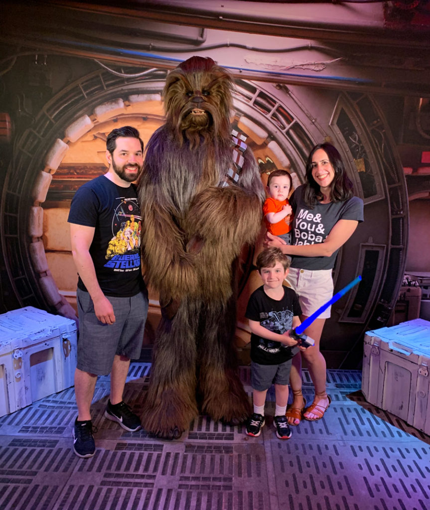 A family meets Chewbacca on Star Wars Day at Sea.