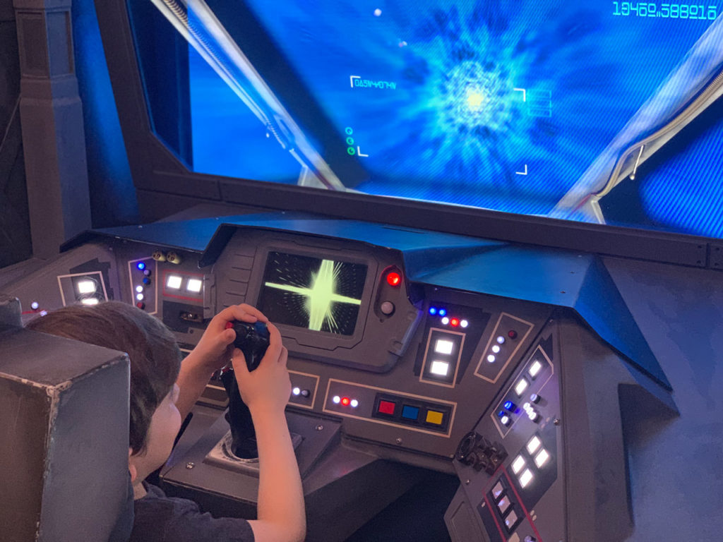 A young fan in the Star Wars Command Center on the Disney Fantasy from Disney Cruise Line.