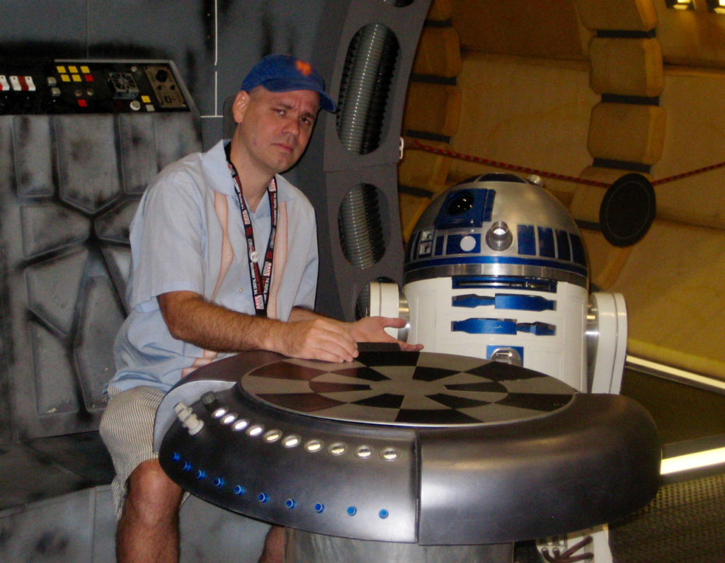 Jason Fry on the Millennium Falcon with R2-D2 at Star Wars Celebration.