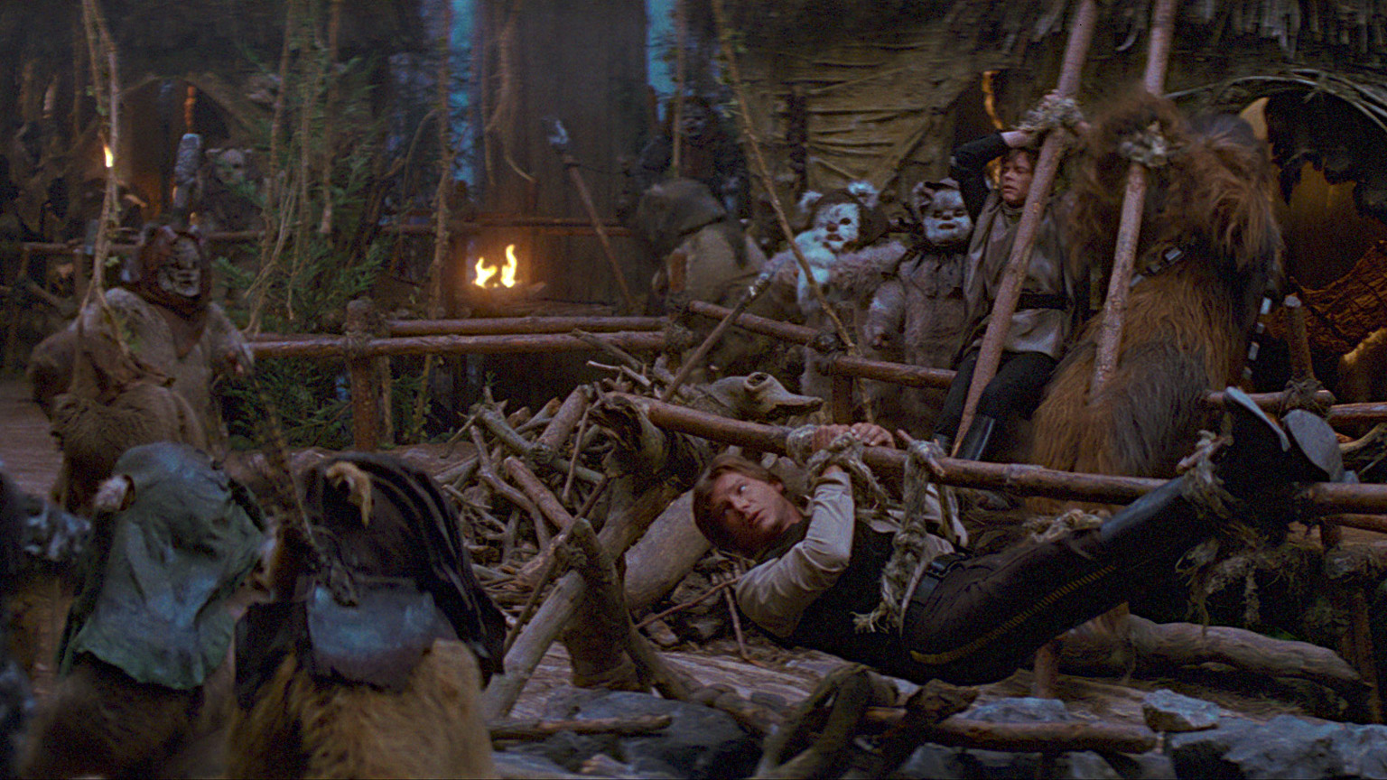 Han and his friends narrowly avoid becoming a feast for an Ewok village.