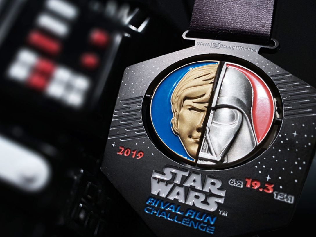 runDisney Rival Run medal in front of a Darth Vader costume.