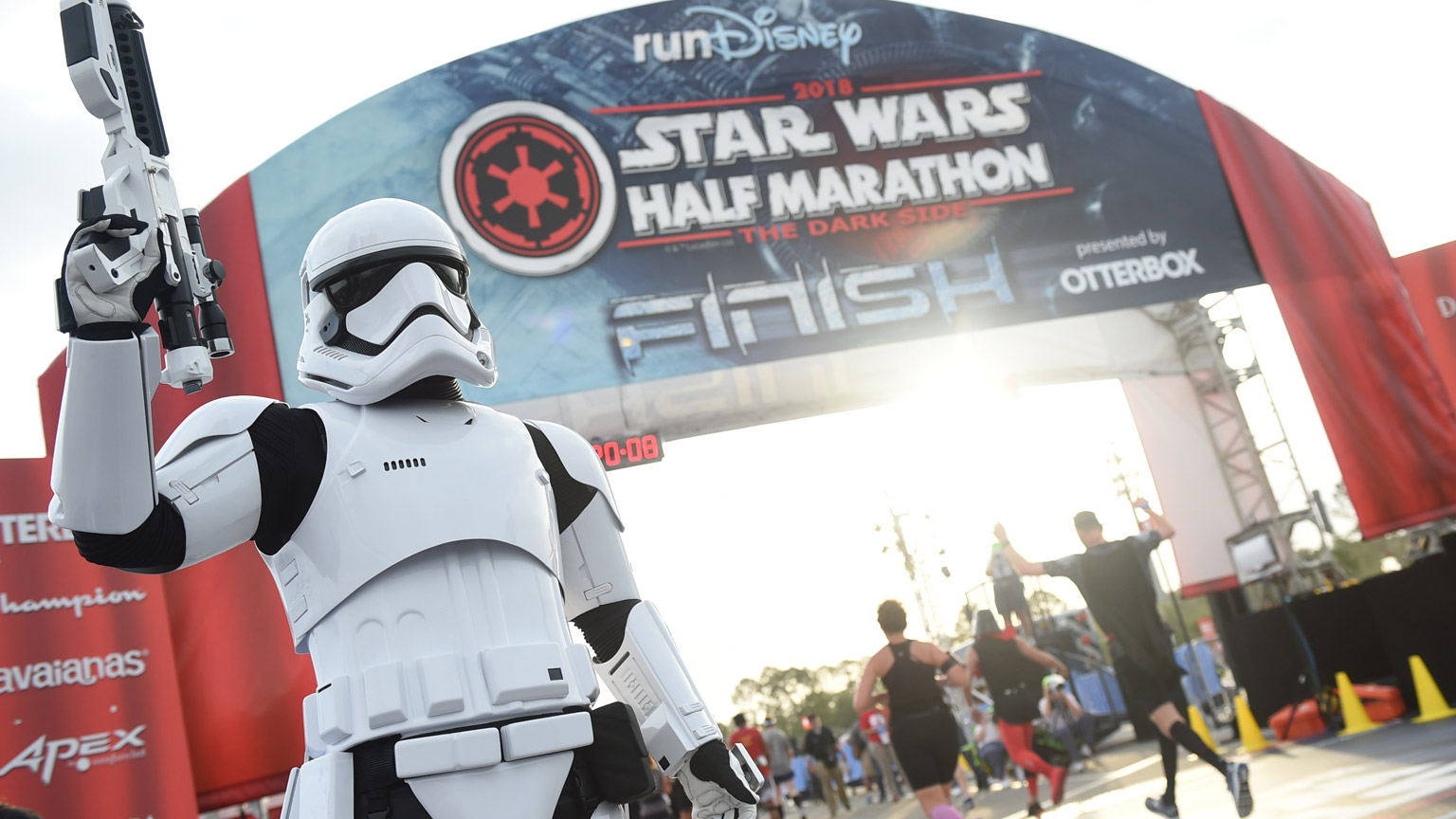 A stormtrooper stands at the finish line for the Star Wars Half Marathon in 2018.