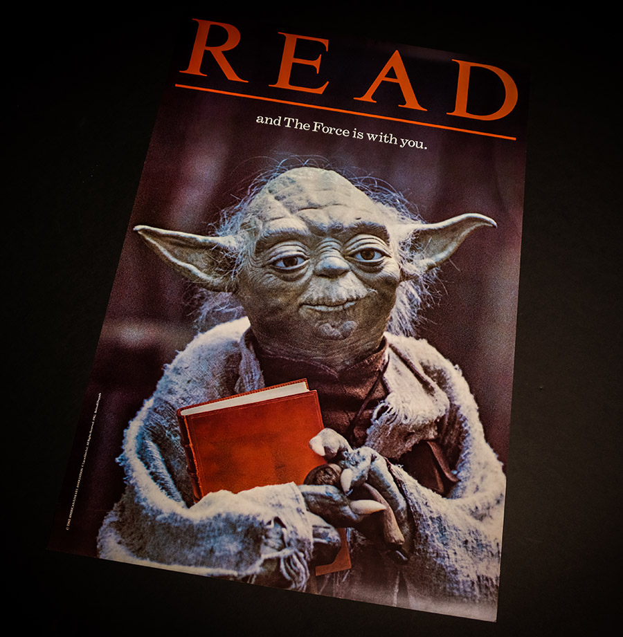 A vintage Read poster featuring Yoda.