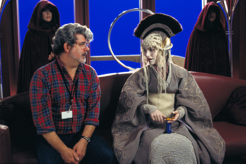 George Lucas with Natalie Portman on the set of The Phantom Menace.