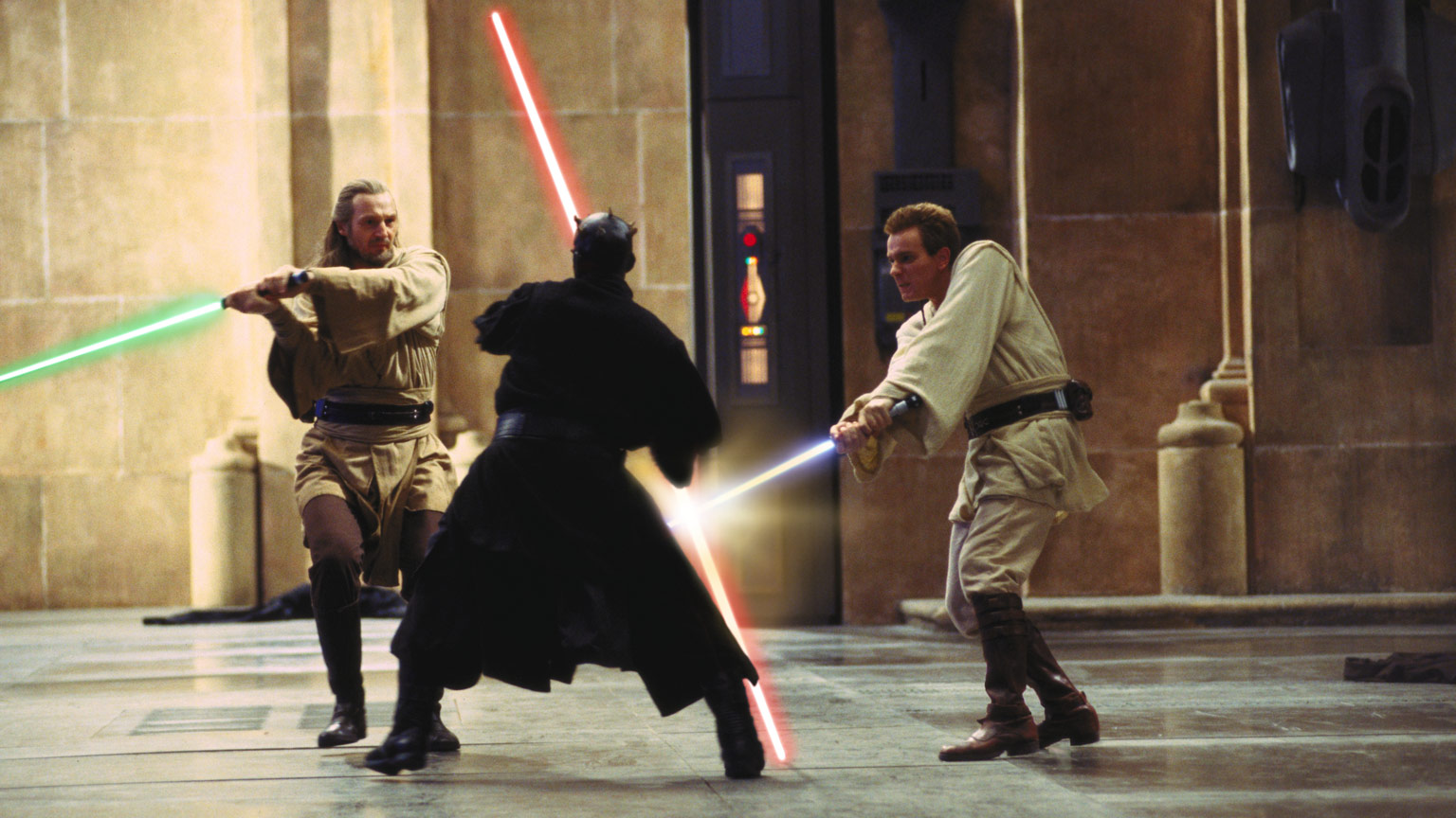 Qui-Gon, Obi-Wan, and Darth Maul duel in The Phantom Menace.