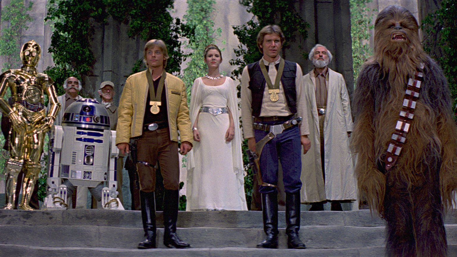 C-3PO, R2-D2, Luke, Leia, Han, and Chewie at the medal ceremony.