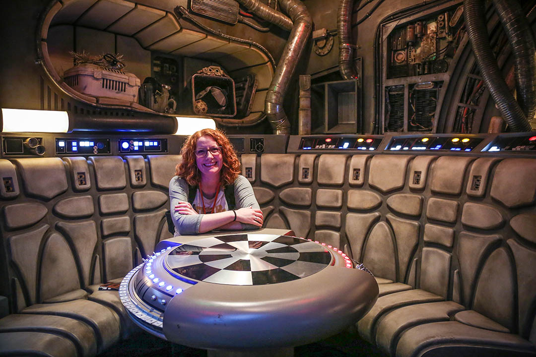 Kristin Baver takes a seat inside the Millennium Falcon at Star Wars: Galaxy's Edge.