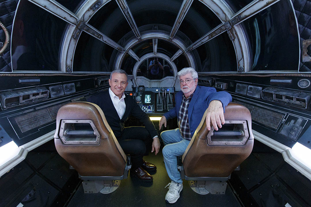 Bob Iger, Walt Disney Company Chairman and CEO (left), and George Lucas, Star Wars creator, pose inside Millennium Falcon: Smugglers Run at Star Wars: Galaxy's Edge at Disneyland Park.