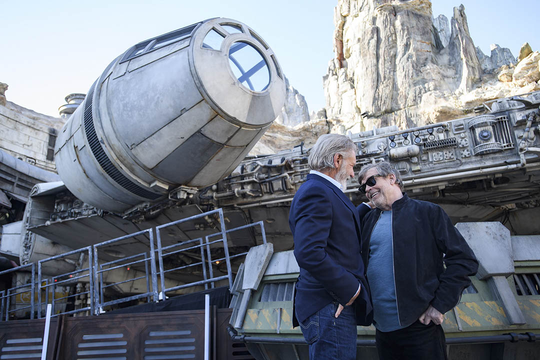 Actors Harrison Ford and Mark Hamill pose in front of the Millennium Falcon at Star Wars: Galaxy's Edge at Disneyland Park May 29, 2019.