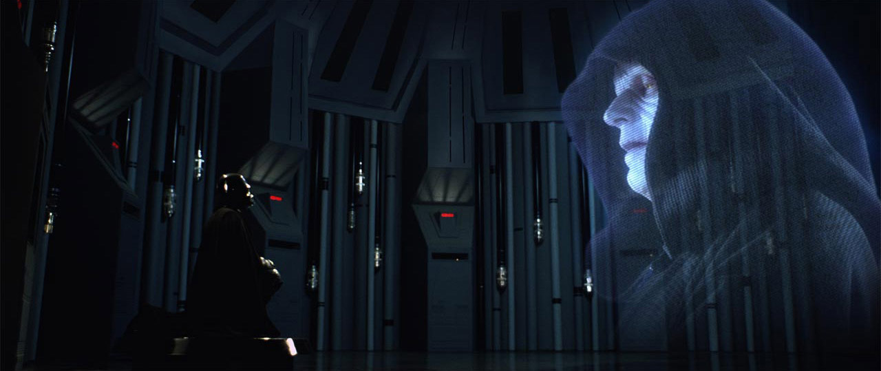 Darth Vader speaks with the Emperor.