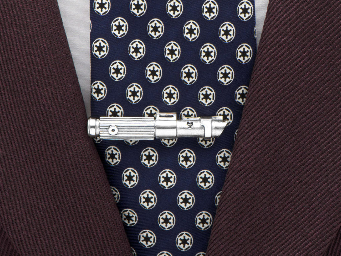 Lightsaber tie clip holding a tie in place.