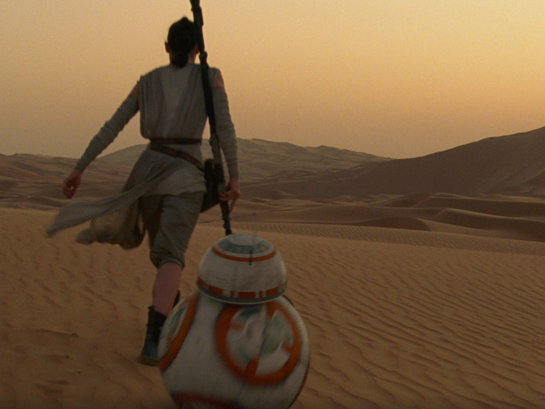 Rey and BB-8 travel on Jakku.