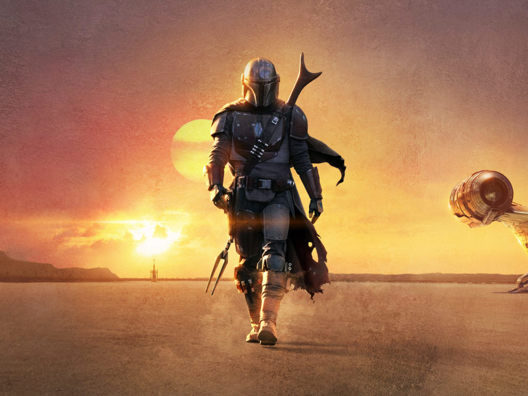 The Mandalorian walks the desert in an image from the series teaser poster