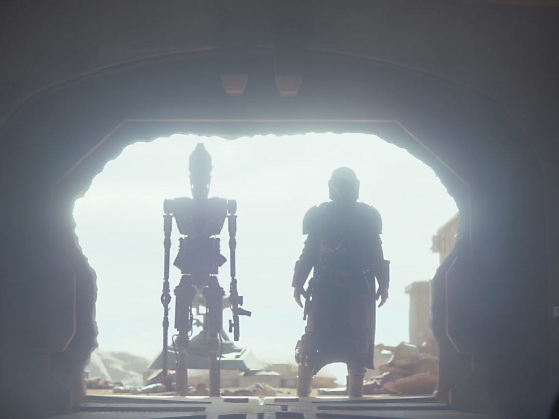 The Mandalorian and IG-11 in a doorway in The Mandalorian series.