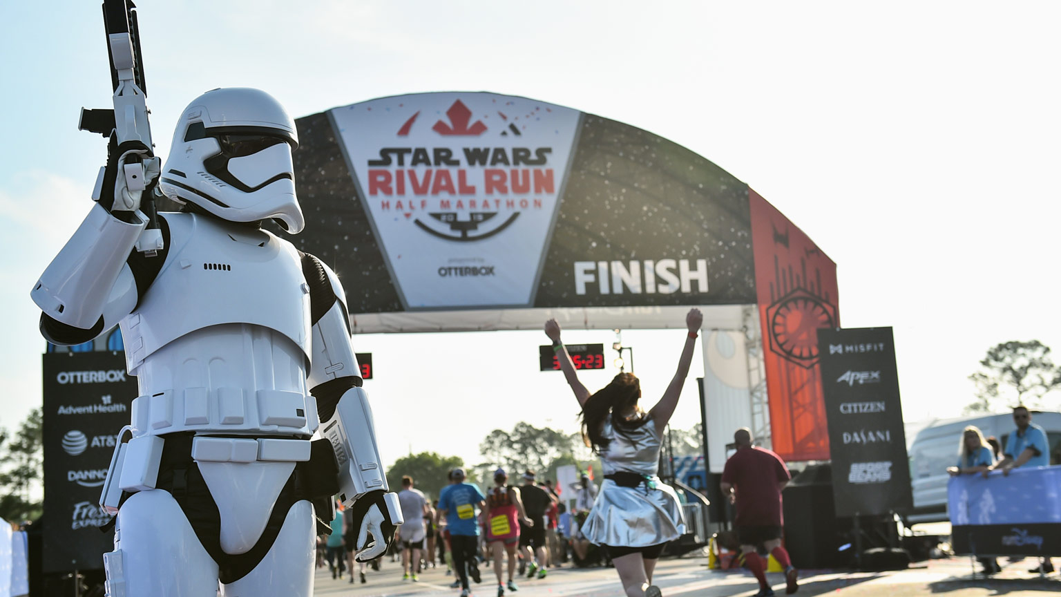 A stormtrooper stands by the runDisney Star Wars Rival Run finish line
