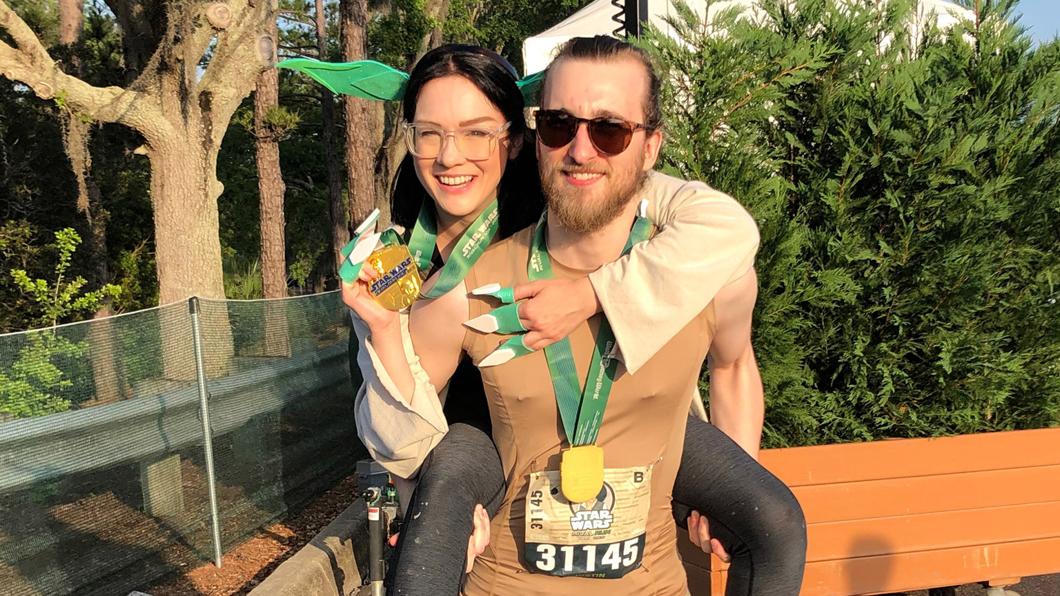 Fox and her boyfriend dressed up as Yoda and Luke after finishing runDisney race