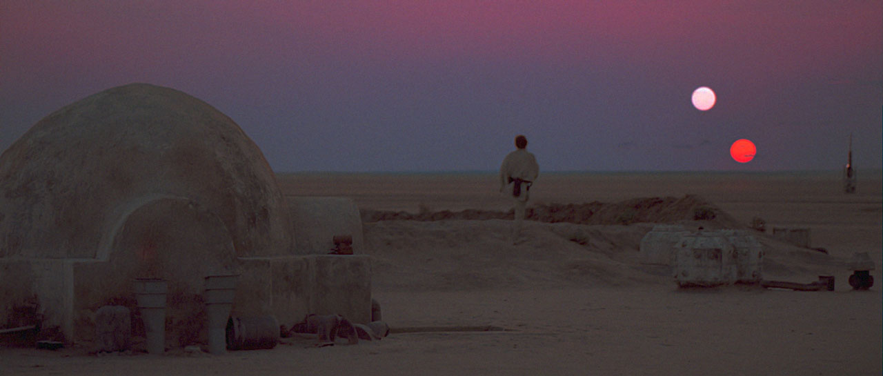 Luke Skywalker watches the suns set on Tatooine.