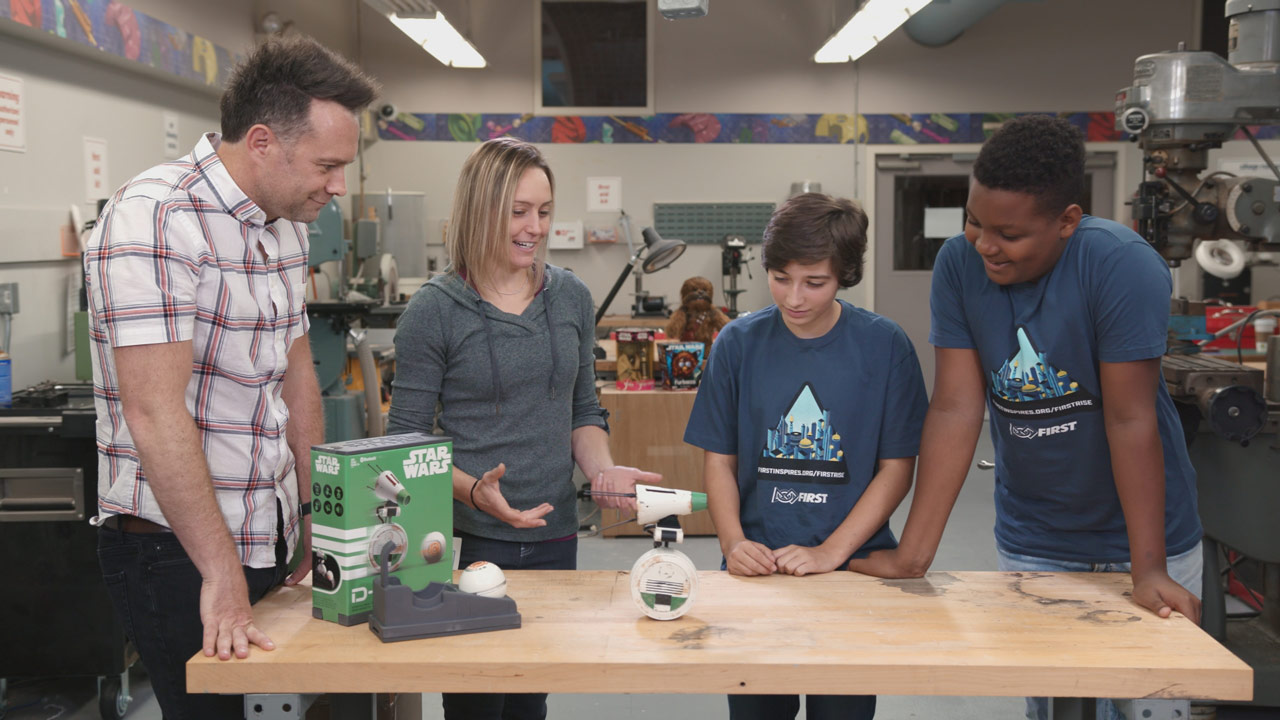 Engineers and students check out Hasbro's D-O App Controlled Droid