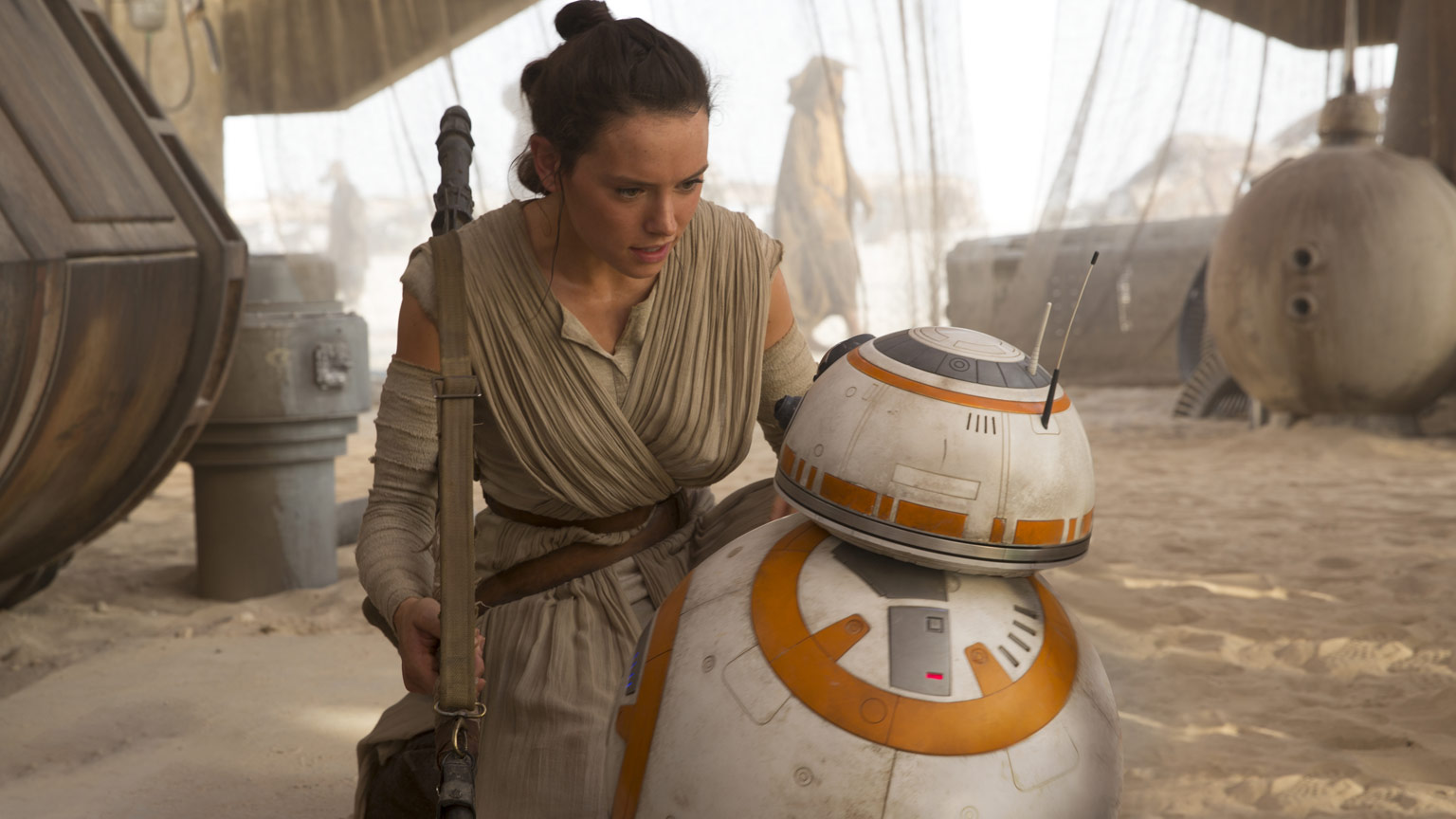 Rey talks to BB-8 in a scene from The Force Awakens.