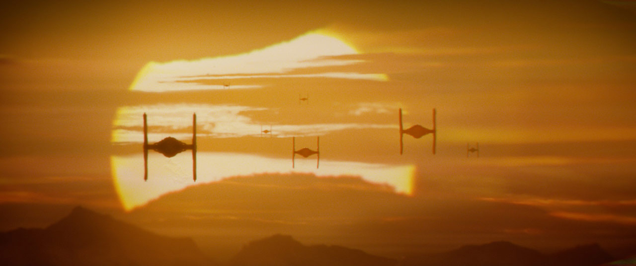 TIE fighters fly with the sun setting in Star Wars: The Force Awakens