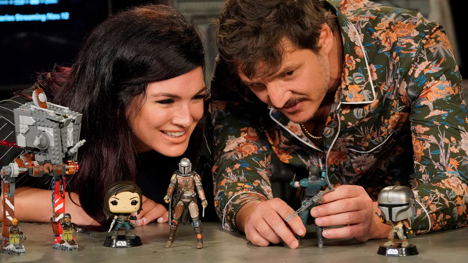 Gina Carano and Pedro Pascal check out new toys from Triple Force Friday.