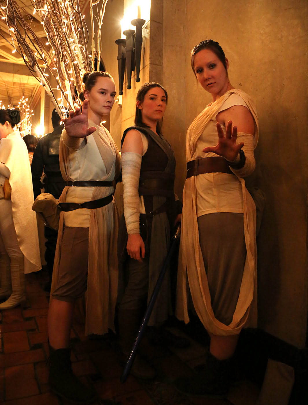 Three cosplayers dressed as Rey for the premiere of The Rise of Skywalker.