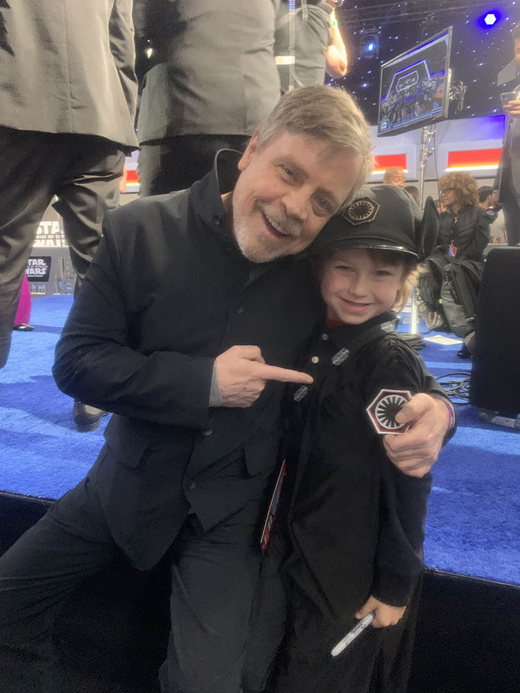 Mark Hamill poses with a young fan.
