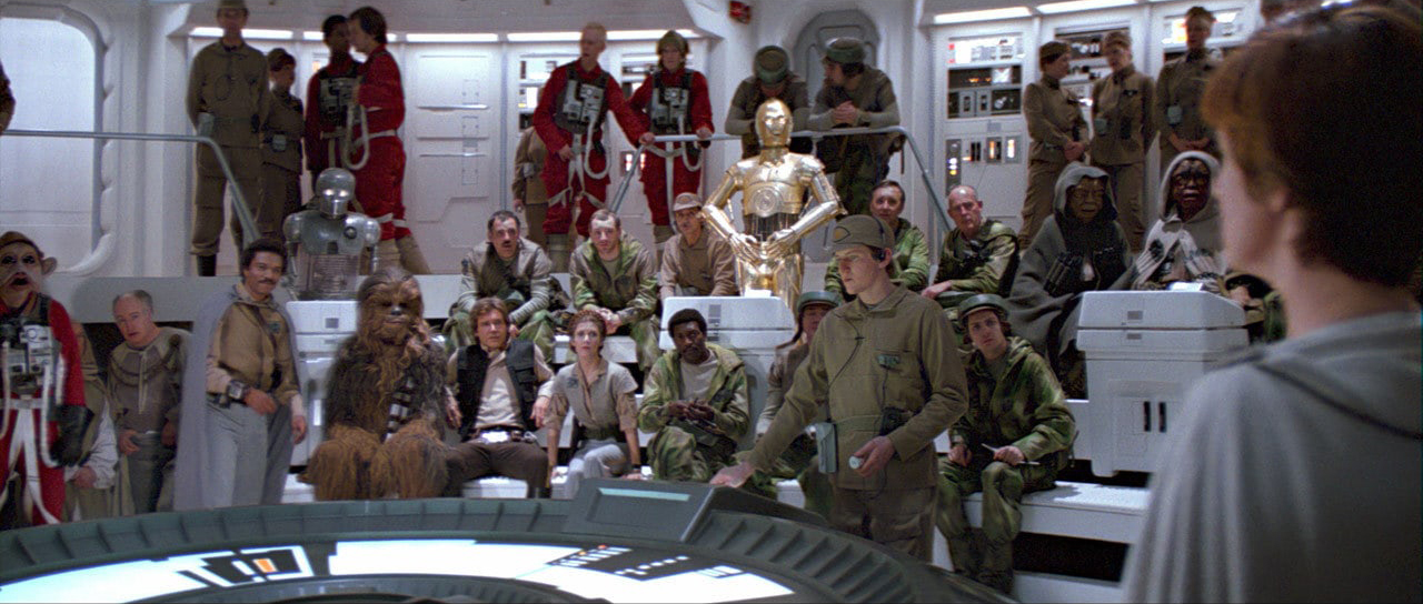 Leia, Luke, Han, Lando, and Chewbacca with Rebel Alliance officers and crew