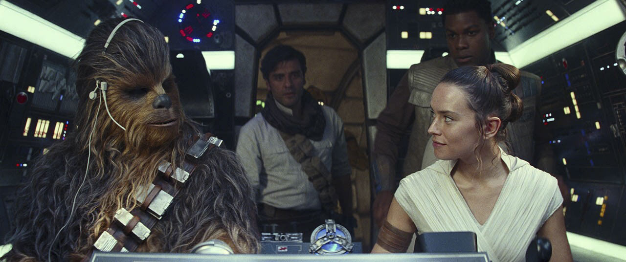 Chewie and Rey flying the Millennium Falcon