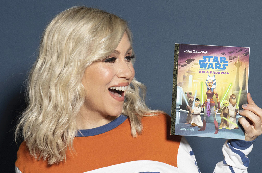 "Ashley Eckstien with her book ""I Am a Padawan"""