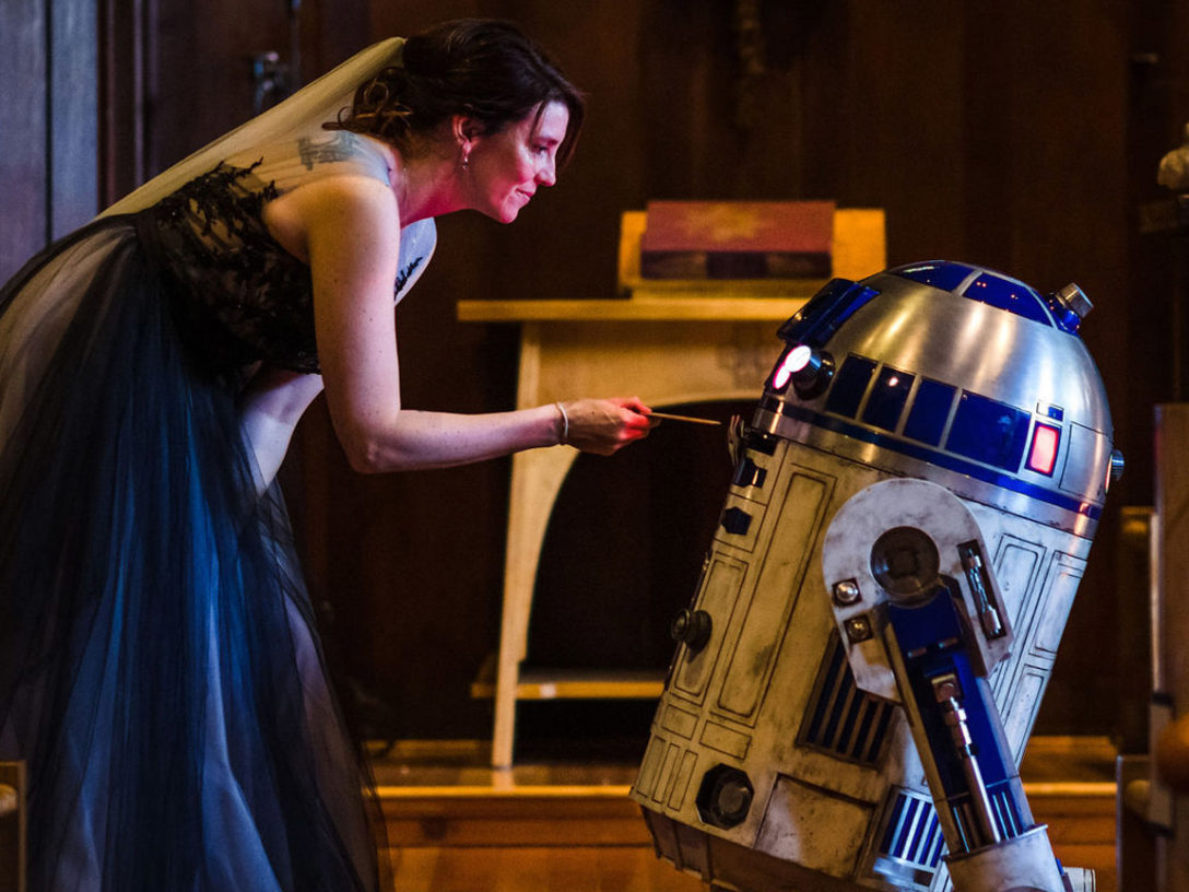 Jenny Safay Ely gives ringbearer R2-D2 an important message.
