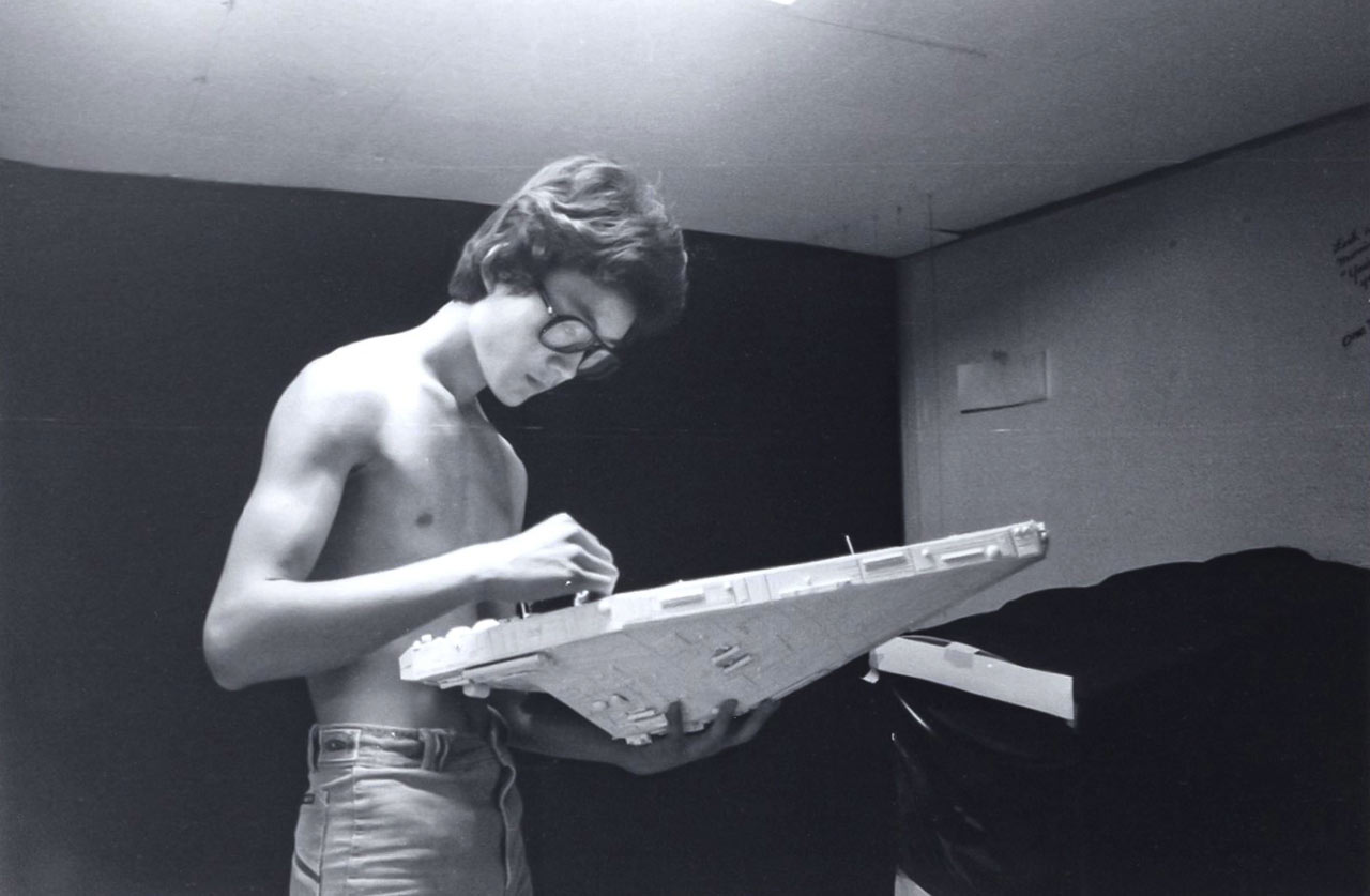 Doug Chiang works on a spaceship made from poster board and model part kits for his film Side One.