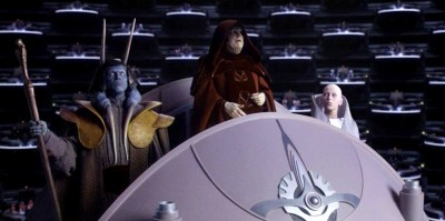 Sly Moore in the Senate Chamber, with Mas Amedda (left) and Chancellor Palpatine (center).